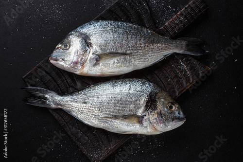 Fototapeta  Fresh dorado fish with ingredients