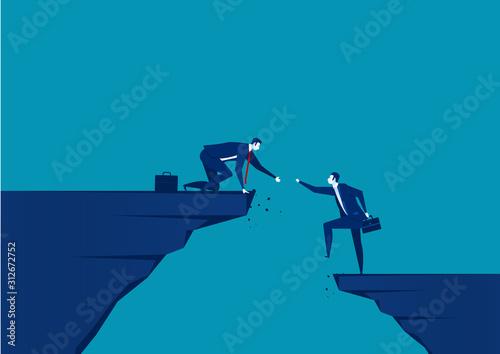 Tablou Canvas businessman helping hands hanging cliff help concept together