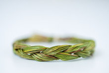 Close Up Of Middle Of Green Fresh Sweetgrass Braid Tied In A Circle Isolated On White Background