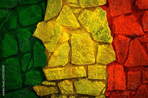 Fototapeta Green yellow red on rock stone texture,reggae background