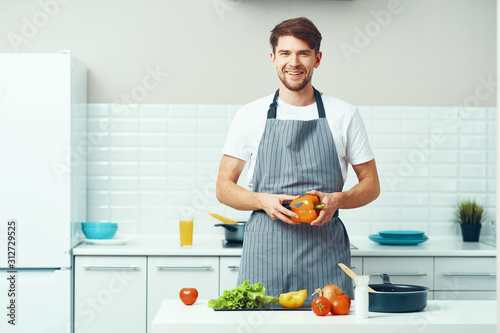 Fototapety, obrazy: man cooking in kitchen