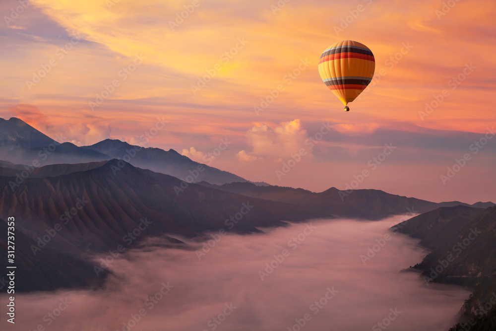 Fototapeta travel on hot air balloon, beautiful inspirational landscape with sunrise colorful sky