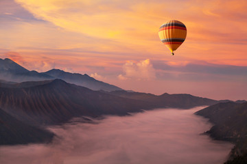 Fototapeta Do hotelu travel on hot air balloon, beautiful inspirational landscape with sunrise colorful sky