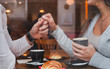 canvas print picture - dating, romantic date in restaurant for couple, man and woman holding hands
