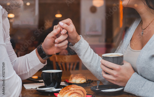 Cuadros en Lienzo dating, romantic date in restaurant for couple, man and woman holding hands