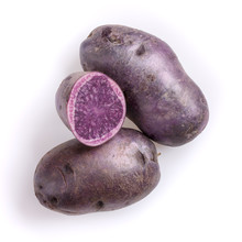 Raw Purple Potatoes Isolated On White Background. Top View, Close-up.