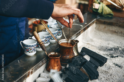 Cooking fresh aromatic traditional Turkish coffee on charcoal Wallpaper Mural