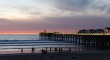 Beachgoers Watch Sunset  Near ...