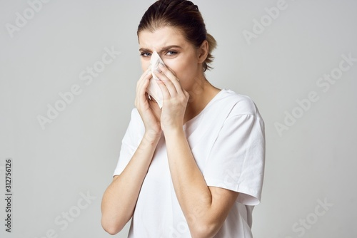 portrait of a woman blowing her nose Wallpaper Mural
