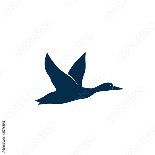 Duck or wild goose isolated flying bird silhouette Fototapet