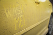 Write the words inscription text wash me on the very dirty surface of the car. Concept car wash.