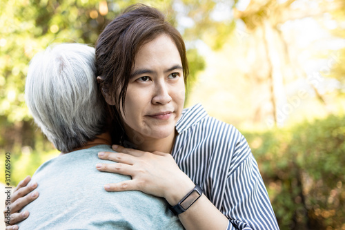 Vászonkép Asian woman pretending to show love to the elderly people by embracing,facial ex