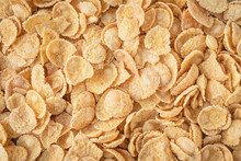 Background Of Corn Flakes. Healthy Breakfast Concept. Yellow Flakes Texture.