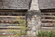 Log Cabin With Yellow Flowers