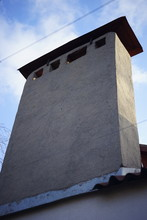 Large Rectangular Chimney On The Roof, Close View From Below