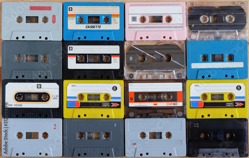 Collection of colorful old audio cassette tape on wooden background Canvas Print