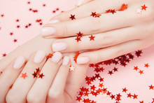 Stylish Trendy Nail Young Woman Hands Pink Manicure On Background With Red Star Confetti