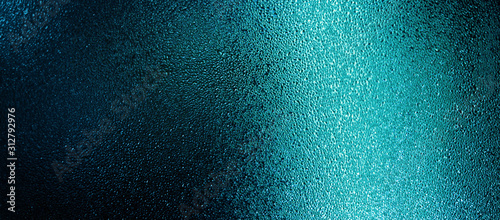 Blue color water drops on wet glass. Abstract texture background. Tableau sur Toile
