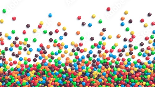 Colorful coated chocolate candies scattered on white background