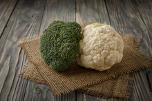 Fresh Cauliflower And Broccoli On Wooden Table