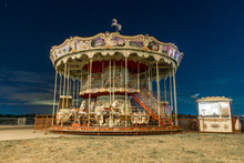 Carousel Against The Night Sky. Vintage Carousel With Horses At Night