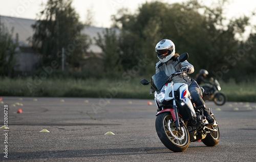 Gymkhana training day. Girl trainings ride motocycle Canvas Print