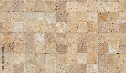 Fototapeta Seamless wall background with Yellow natural sandstone tiles stitched together w