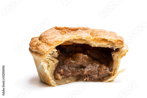 Puff pastry steak pie on baking paper isolated on white Fotobehang