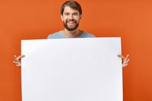 Man Holding Blank Board
