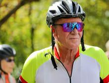 Senior Man Wearing Bike Helmet...