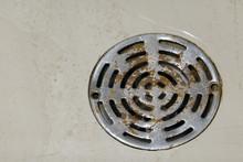 Old Rusty Round Shower Drain Strainer In Bathroom Floor.