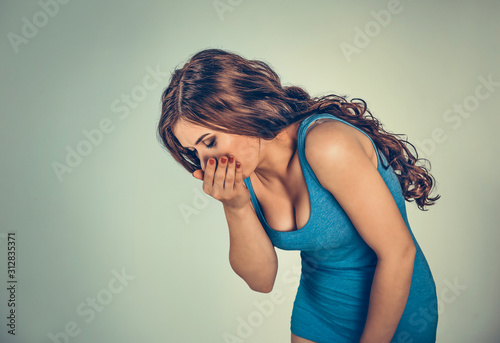 Fotografie, Tablou Young woman feeling nauseated about to vomit.