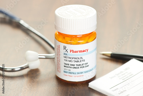 Photo Generic Metroprolol Prescription on physician's desk with stethoscope and prescr