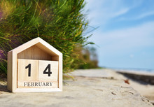 Happy Valentines Day Concept, Wooden Calendar On February 14 In Soft Focus Background.