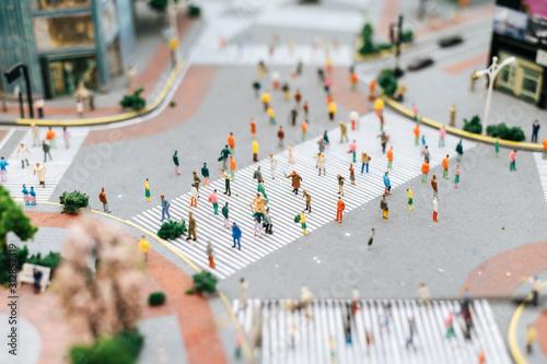 Fotografia, Obraz  Small people or small people walk on many streets.