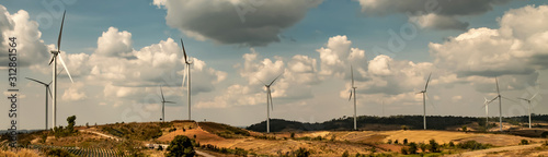 Obraz panorama wind turbine on hill. energy power in nature. eco concept - fototapety do salonu