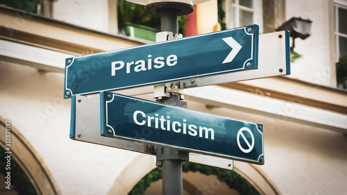 Photo Street Sign Praise versus Criticism