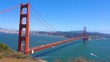 View of the Golden Gate landmark with San Francisco green hills on a background
