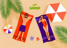 Summer Concept - Couple On The Beach Top View. Man And Woman Sunbathing On Beach.