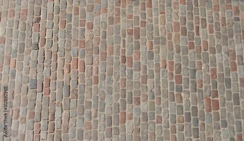 Canvas Print Old cobblestone pavement top view