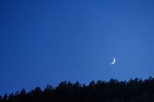 Thin Crescent Moon In The Blue Sky Of The Twilight