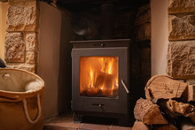 Wood Fireplace In Cosy House In Winter