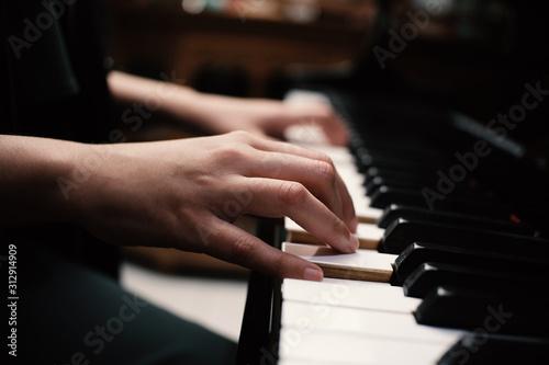 Beautiful asian girl learn to play piano. - 312914909