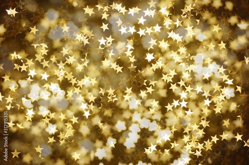 Weihnachtlicher Hintergrund mit goldenen Sternen auf dunklem Untergrund Canvas-taulu