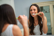 Young Woman Is Brushing Her Te...