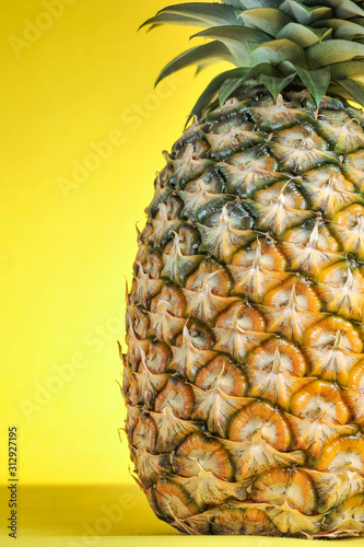 Fototapety, obrazy: Pineapple on bright yellow background. Fresh pineapple on bright yellow background.