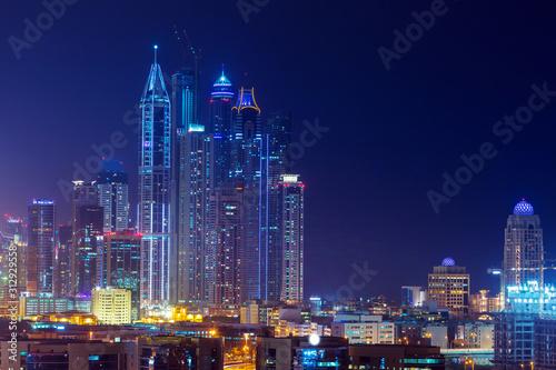 Fototapety, obrazy: Skyscrapers of Dubai Marina at night, United Arab Emirates