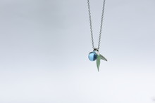 Beautiful Necklace And Blue Gemstone Pendant With Ring Decorated By Silver In Shape Of Dolphin Fins