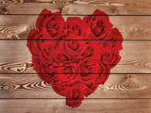 Red Heart Formed With Roses On  Rustic Wooden  Background