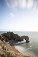Durdle Door, A Natural Limestone Arch On The Jurassic Coast Of Dorset, England